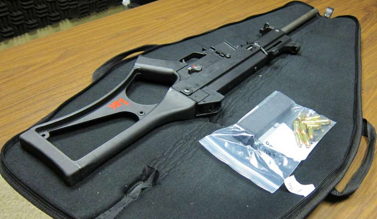 Police arrested a 26-year-old Stamford man for allegedly carrying this stolen Heckler & Koch USC carbine in a rifle bag early Tuesday morning, about an hour after police investigated reports of gunfire on the West Side. The weapon uses .45-caliber rounds and was allegedly stolen from somewhere in Bridgeport, Stamford police said. The rifle bag contained 16 bullets.