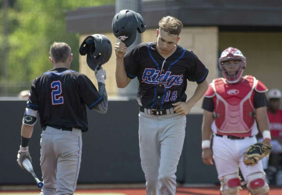 Oak Ridge rightfieder Zach Easterling (18) and center fielder Cole Rollins (2) tap their helmets together after Easterling hit a home run during a Region II-6A bi-district playoff game Saturday, May, 4, 2019 at Grand Oaks High School in Spring Photo: Cody Bahn, Houston Chronicle / Staff Photographer / © 2018 Houston Chronicle