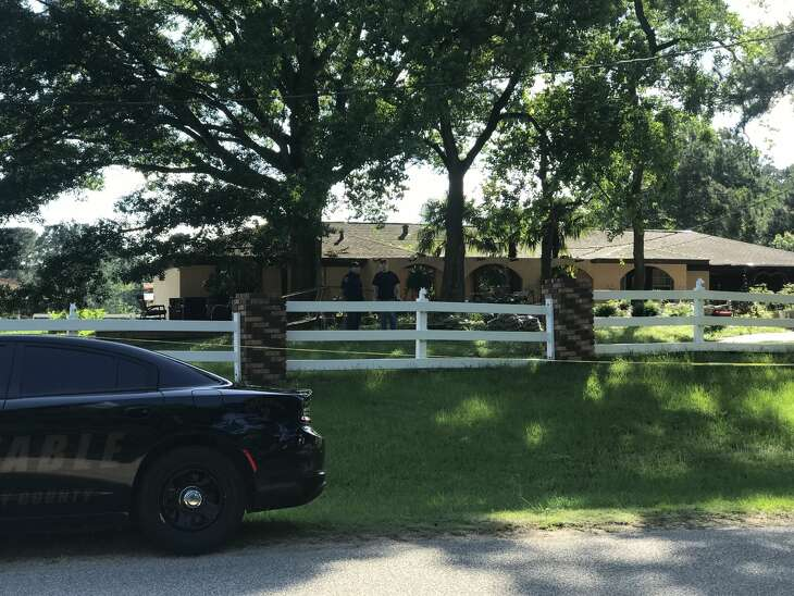Deputies cordon off the area in the 10700 block of Stidham Road in Conroe, Texas. A 10-year-old boy was shot and killed, and a juvenile is being questioned in his death.