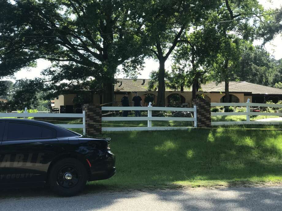Deputies cordon off the area in the 10700 block of Stidham Road in Conroe, Texas. A 10-year-old boy was shot and killed, and a juvenile is being questioned in his death. Photo: Meagan Ellsworth/Conroe Courier