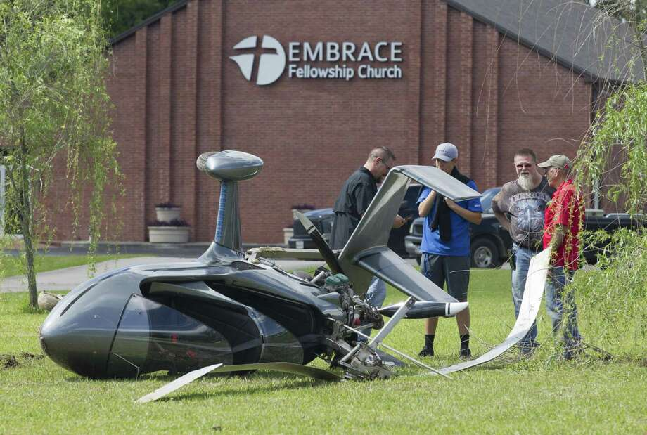 A gyrocopter is seen after its pilot from Anahuac crash the aircraft while attempting an autorotation into a church parking lot on Antique Lane and overcorrected, Saturday, May 4, 2019, in New Caney. The pilot, who was on his way home from nearby Cleveland, suffered a groin injury in the crash, but did not require further medical treatment. Photo: Jason Fochtman, Houston Chronicle / Staff Photographer / © 2019 Houston Chronicle