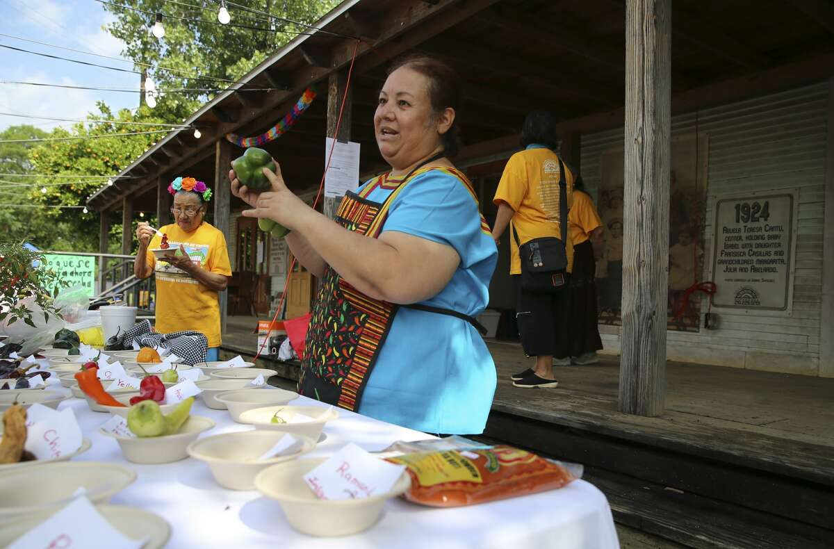 """Blanca Rivera talks about the various aspects of chilis and peppers used in Latin cooking on Saturday, May 4, 2019 as The Esperanza Peace and Justice Center hosts Paseo por el Westside, a historic and cultural preservation community gathering on the Westside of San Antonio. This year's theme Mi Barrio No Se Vende seeks to highlight the nationwide housing crisis that significantly impacts low income communities like the westside. The yearly celebration highlights the history, culture and people who live there, but this time there's a message to the downtown expansion encroaching on on the area, """"Mi Barrio No Se Vende!"""" which in English means """"My neighborhood is not for sale!"""" (Kin Man Hui/San Antonio Express-News)"""