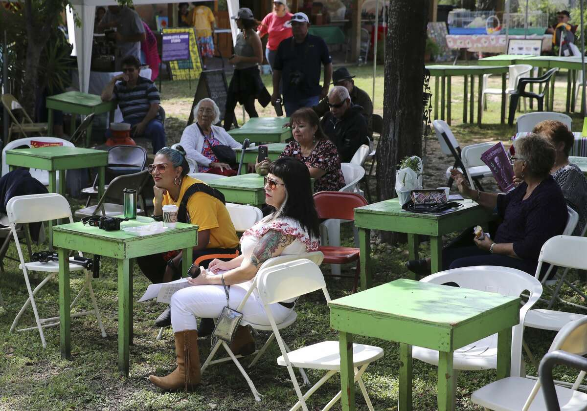 """Guests relax in the shade while listening to music as The Esperanza Peace and Justice Center hosts Paseo por el Westside, a historic and cultural preservation community gathering on the Westside of San Antonio. This year's theme Mi Barrio No Se Vende seeks to highlight the nationwide housing crisis that significantly impacts low income communities like the westside. The yearly celebration highlights the history, culture and people who live there, but this time there's a message to the downtown expansion encroaching on on the area, """"Mi Barrio No Se Vende!"""" which in English means """"My neighborhood is not for sale!"""" (Kin Man Hui/San Antonio Express-News)"""