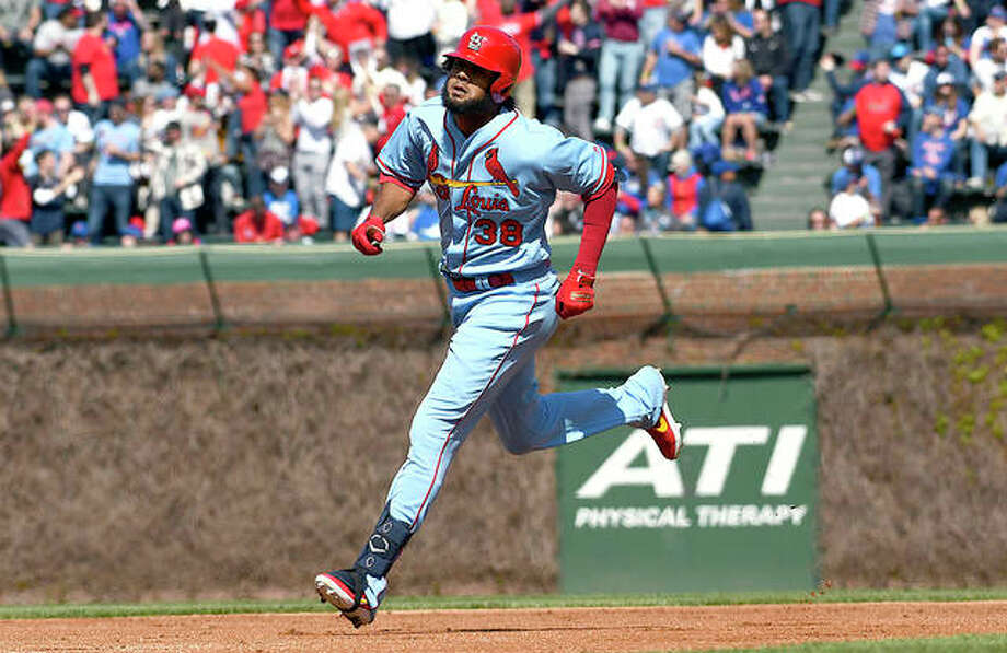The Cardinals' Jose Martinez (38) rounds the bases after hitting a home run in the second inning of Saturday's game against the Cubs at Wrigley Field. Photo: AP Photo