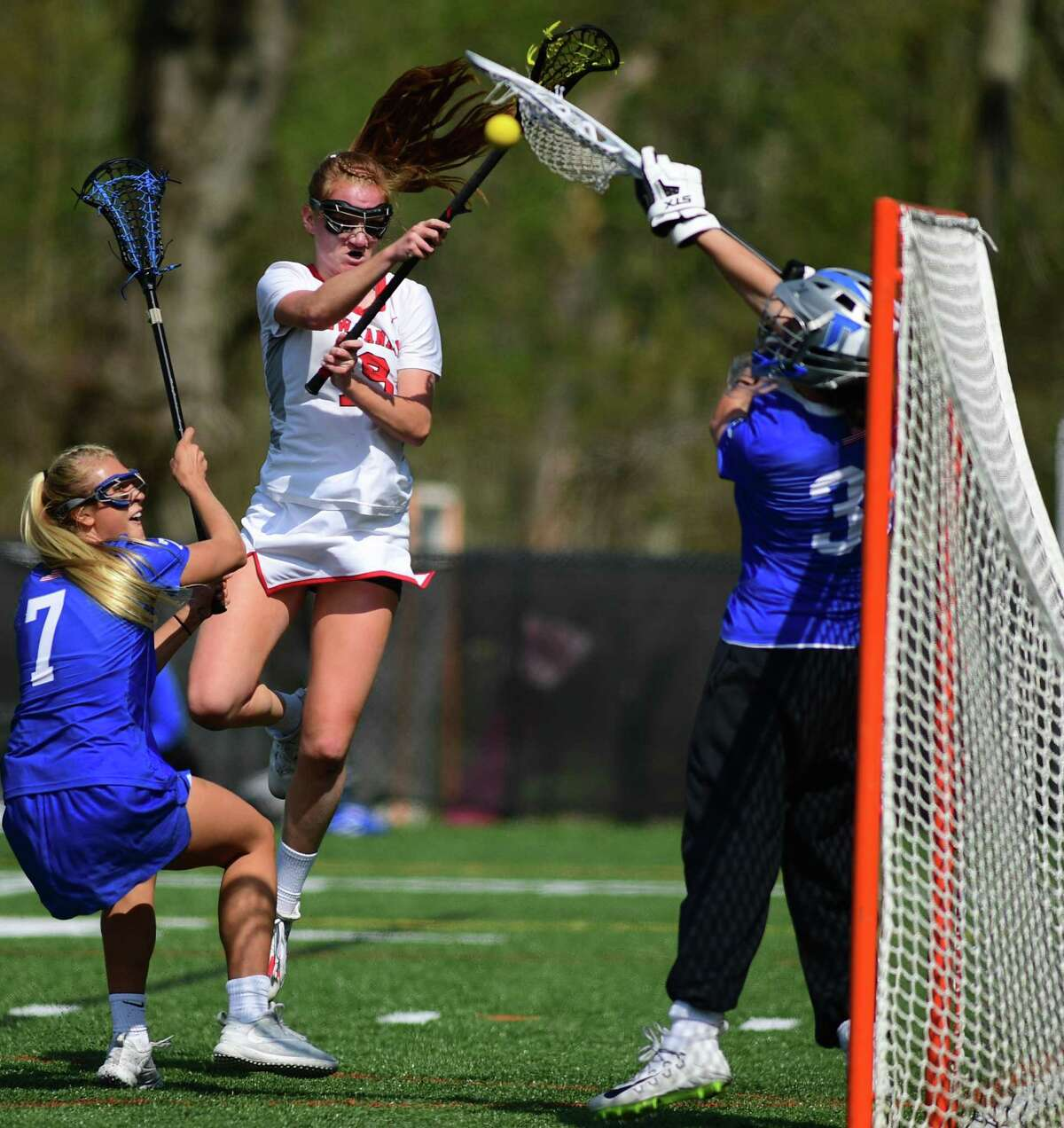 Blue Wave #7 and Goalie Shea Dolce defend agains Rams #19 Jane Charlton The No. 1 Darien High School Blue Wave takes on the New Canaan Highh School Rams in their FCIAC girls lacrosse game Saturday. May 4, 2019, in New Canaan, Conn. New Canaan girls lacrosse team defeated the rival Darien Blue Wave 12-11 in the Class L semifinals last spring.