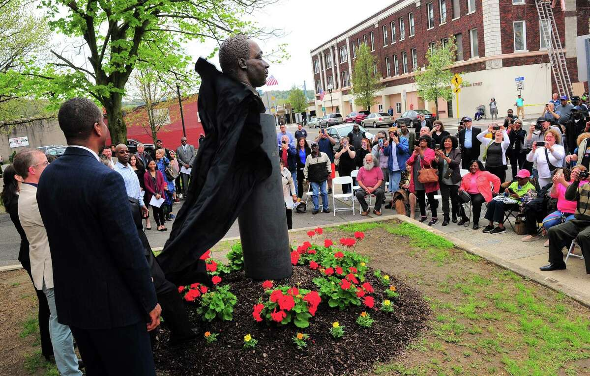 The bust of Martin Luther King Jr. that sculptor Vasil Rakaj created is unveiled in front of City Hall in Ansonia on Saturday.