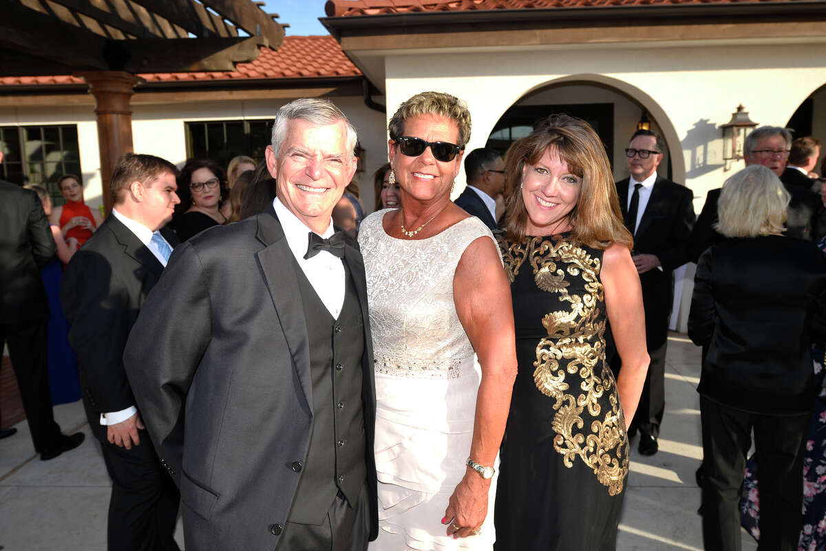 From left, George Friesen, JoAnne Friesen, and Daila Guss, photographed during the Black and Gold Ball fundraiser for Holy Cross High School, May 4, 2019 at The Way Retreat Center. James Durbin/Reporter-Telegram