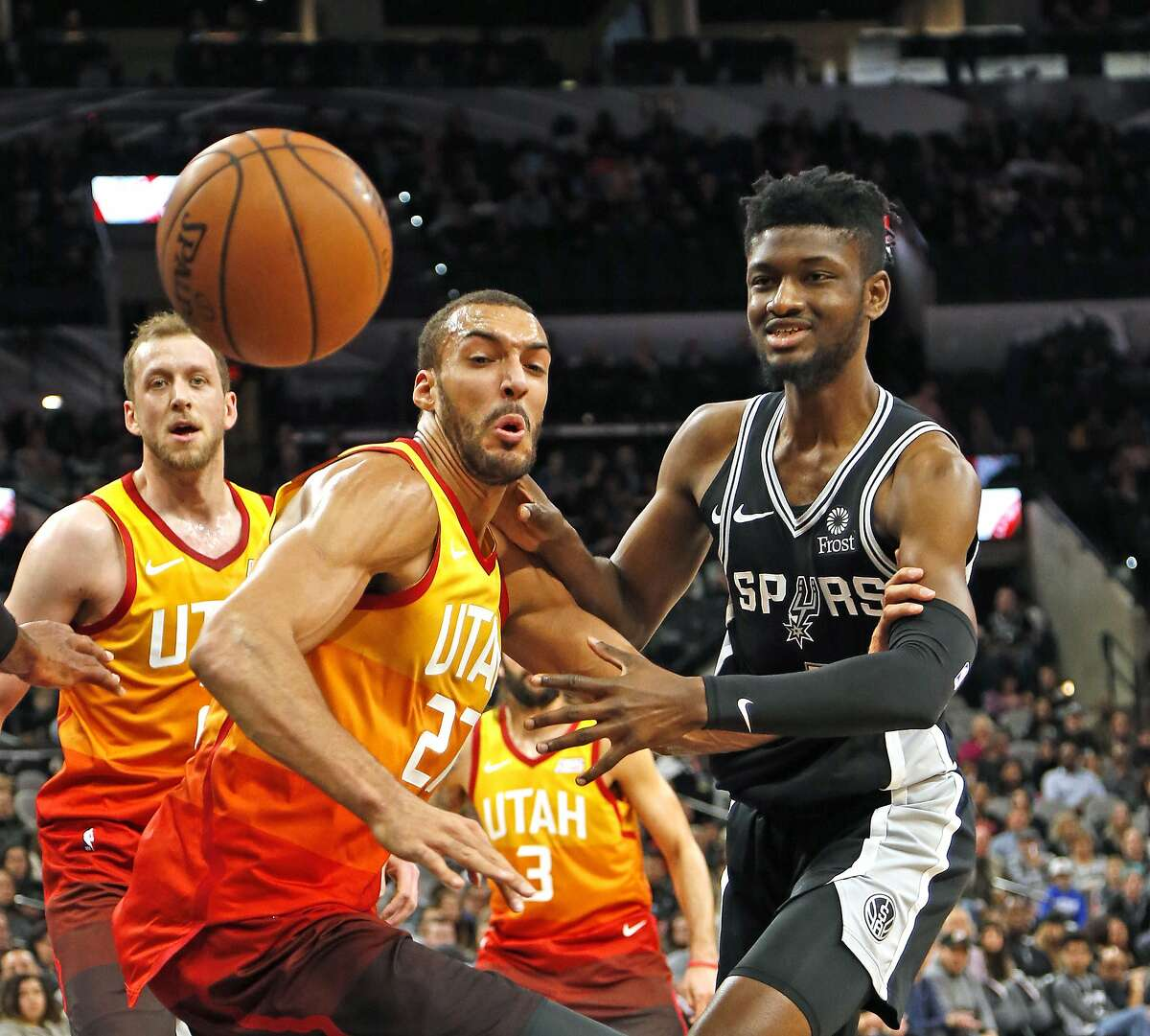 Chimezie Metu #7 of the San Antonio Spurs and Rudy Gobert #27 of the Utah Jazz watch the ball go out of bounds. Utah Jazz v San Antonio Spurs on Sunday, December 9, 2018 at the AT&T Center.