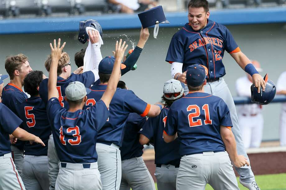 Brandeis' Oscar Cardenas, top, is greeted at home plate after hitting a grand slam in Game 2 of their best-of-thee first-round Class 6A baseball playoff series with Madison at North East Sports Park on Saturday, May 4, 2019. Brandeis beat Madison 9-2 to sweep the series. Photo: Marvin Pfeiffer, Staff Photographer / Express-News 2019