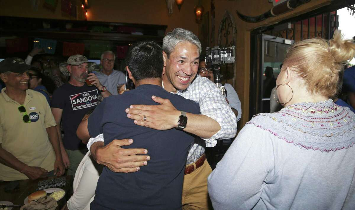 """Mayor Ron Nirenberg greets supporters during an election night watch party at Augie's Barbecue. The incumbent said, """"Guess what? Progress isn't easy."""""""