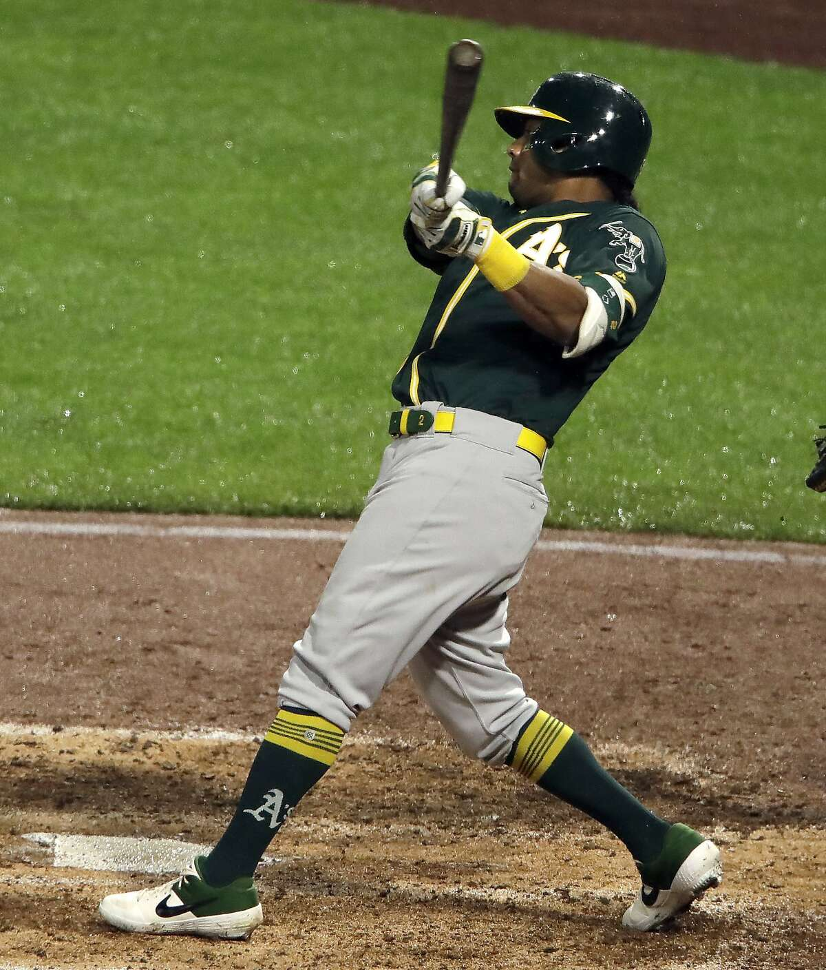 Oakland Athletics' Khris Davis drives in a run with a single off Pittsburgh Pirates starting pitcher Trevor Williams during the fifth inning of a baseball game in Pittsburgh, Saturday, May 4, 2019. (AP Photo/Gene J. Puskar)