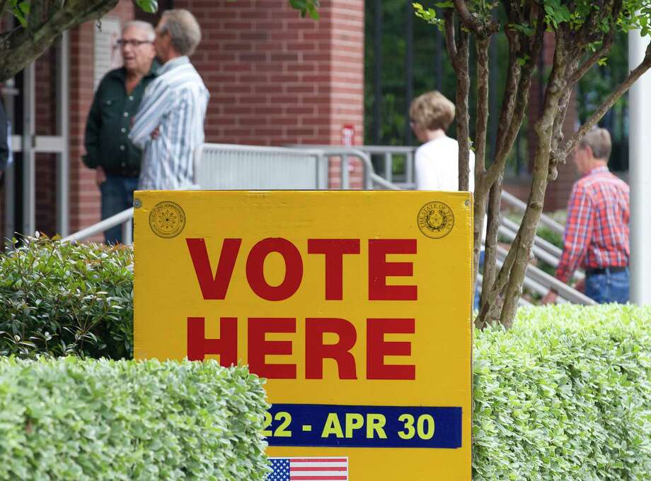 Residents arrive at Lee G. Alworth Building as municipal voting continued in 2019. Primary elections are set for March 3 with Early Voting starting on Feb. 18. A Republican candidate forum takes place on Jan. 14 in Willis. Photo: Jason Fochtman, Houston Chronicle / Staff Photographer / © 2019 Houston Chronicle