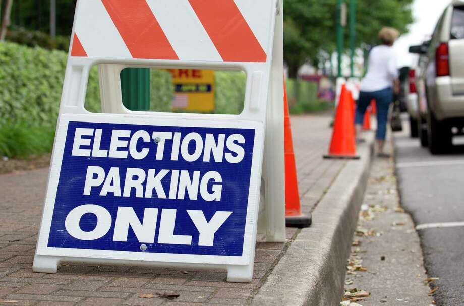 The Conroe Independent School District has less than a month to decide whether to call a bond election for this November's ballot. The final day to call for another bond is Aug. 19. Here, an election parking sign is seen in front of Lee G. Alworth Building as municipal voting continues, Tuesday, April 23, 2019, in Conroe. Election Day is May 4. Photo: Jason Fochtman, Houston Chronicle / Staff Photographer / © 2019 Houston Chronicle