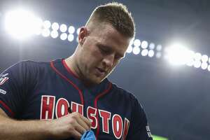 Houston Texans defensive lineman J.J. Watt signs t-shirts to throw into the stands during the J.J. Watt Foundation Charity Classic at Minute Maid Park Saturday, May 4, 2019, in Houston. The foundation's mission is to provide funding for middle schools across the country that have insufficient or no funding for after-school athletic programs.