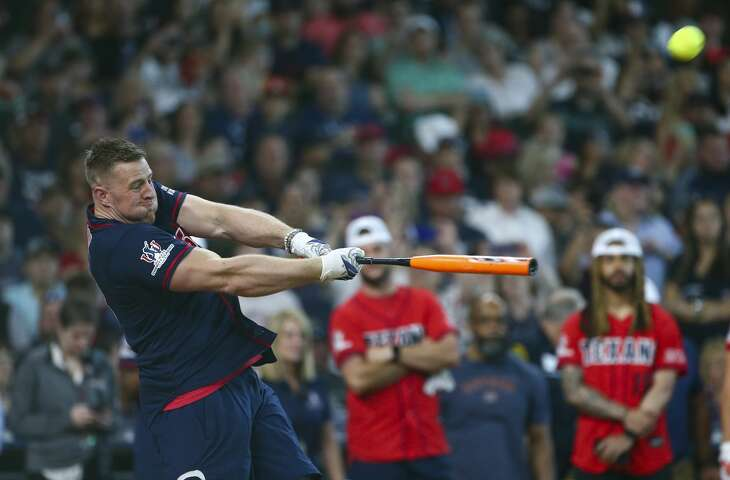 Houston Texans offensive lineman J.J. Watt hits a home run during the home-run derby of the J.J. Watt Foundation Charity Classic at Minute Maid Park Saturday, May 4, 2019, in Houston. The foundation's mission is to provide funding for middle schools across the country that have insufficient or no funding for after-school athletic programs.
