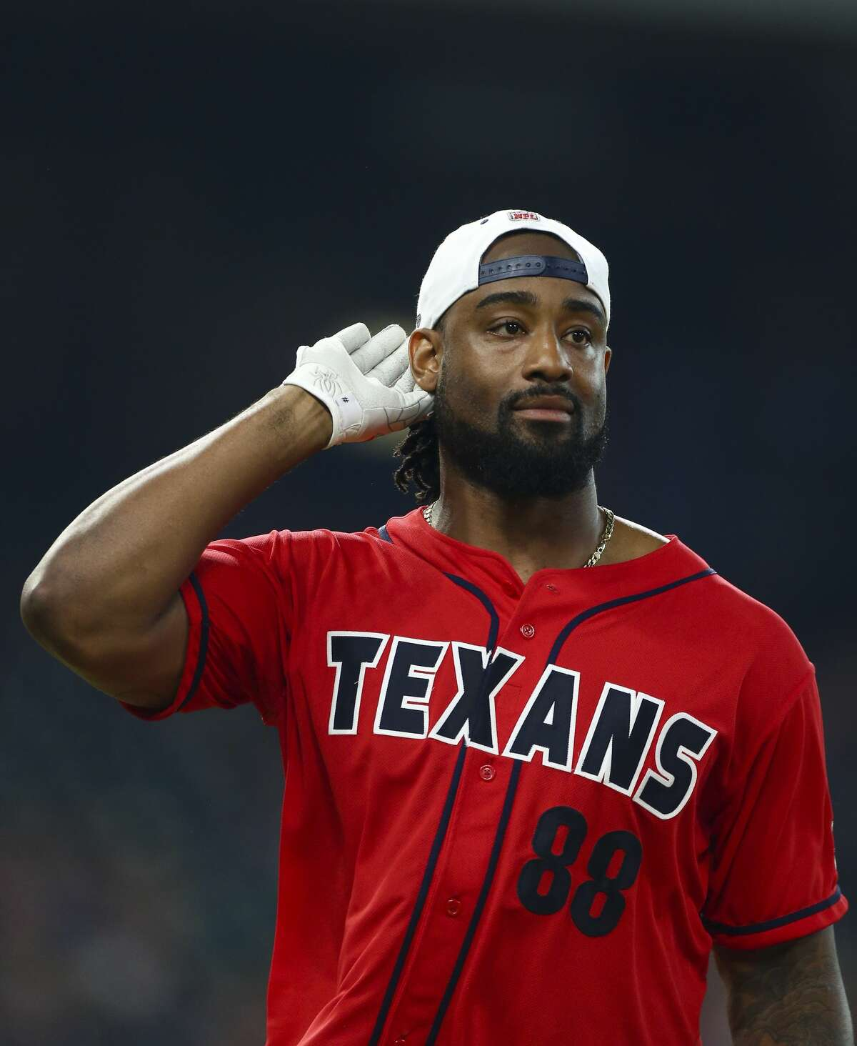 Houston Texans tight end Jordan Akins celebrates after hitting a home run against the defense during the J.J. Watt Foundation Charity Classic at Minute Maid Park Saturday, May 4, 2019, in Houston. The foundation's mission is to provide funding for middle schools across the country that have insufficient or no funding for after-school athletic programs.