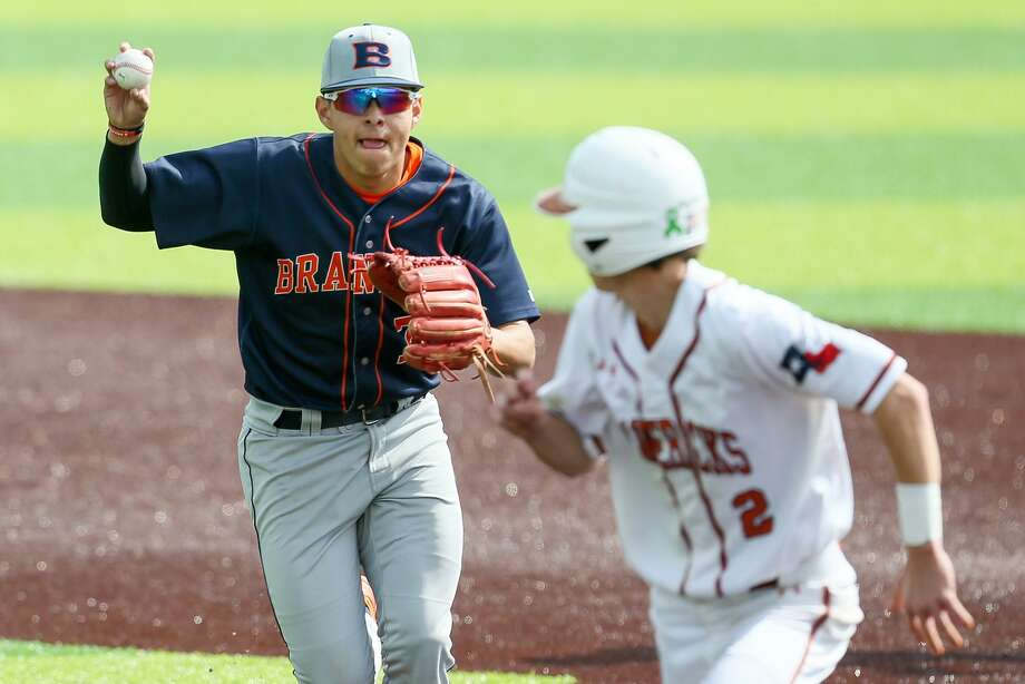 Brandeis' Aric Vasquez, left, chases Madison's Ryan Child back to first base during Game 2 of their best-of-thee first-round Class 6A baseball playoff series at North East Sports Park on Saturday, May 4, 2019. Brandeis beat Madison 9-2 to sweep the series. Photo: Marvin Pfeiffer, Staff Photographer / Express-News 2019