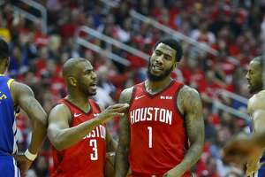 Houston Rockets guard Chris Paul (3) talks to guard Iman Shumpert (1) during the first quarter of Game 3 of a NBA Western Conference semifinal playoff game at Toyota Center, in Houston , Saturday, May 4, 2019.
