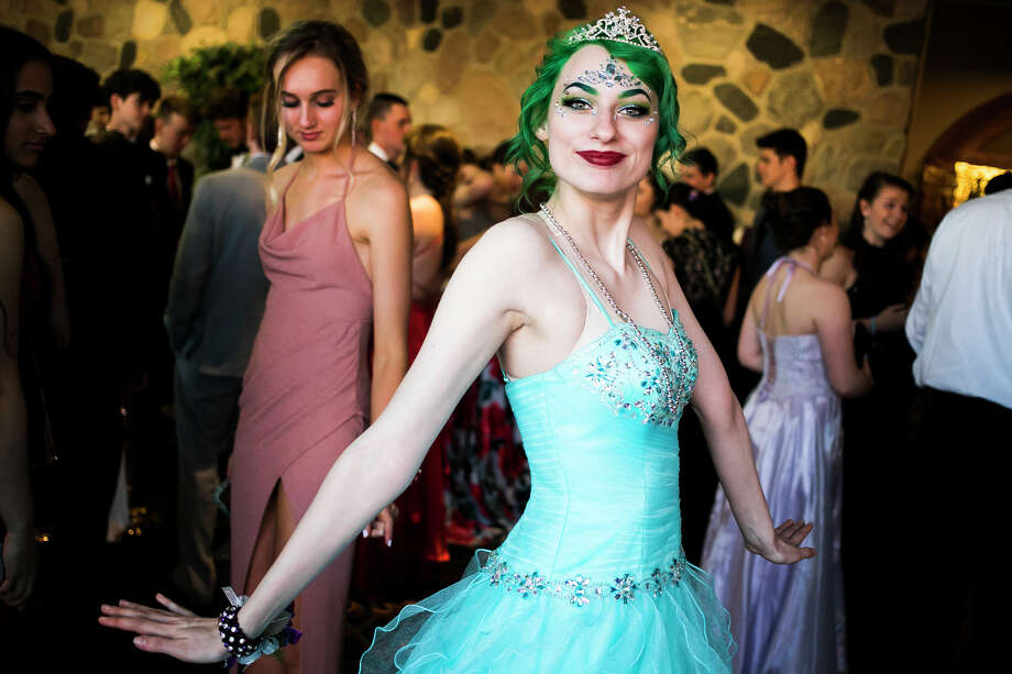 Midland senior Alayna Dewey wears a tiara during the Midland High and Dow High combined prom on Saturday, May 4, 2019 at the Great Hall Banquet & Convention Center in Midland. (Katy Kildee/kkildee@mdn.net) Photo: (Katy Kildee/kkildee@mdn.net)