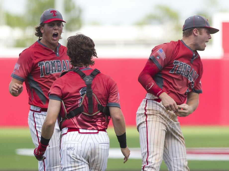Tomball starting pitcher Cody Ryan (1) reacts toward catcher Eli Kerim (8) beisde relief pitcher Eric Oakes (4) reacts after the team's 4-3 win in Game 3 of a Region III-5A bi-district high school baseball playoff series, Saturday, May 4, 2019, in Crosby. Photo: Jason Fochtman/Staff Photographer