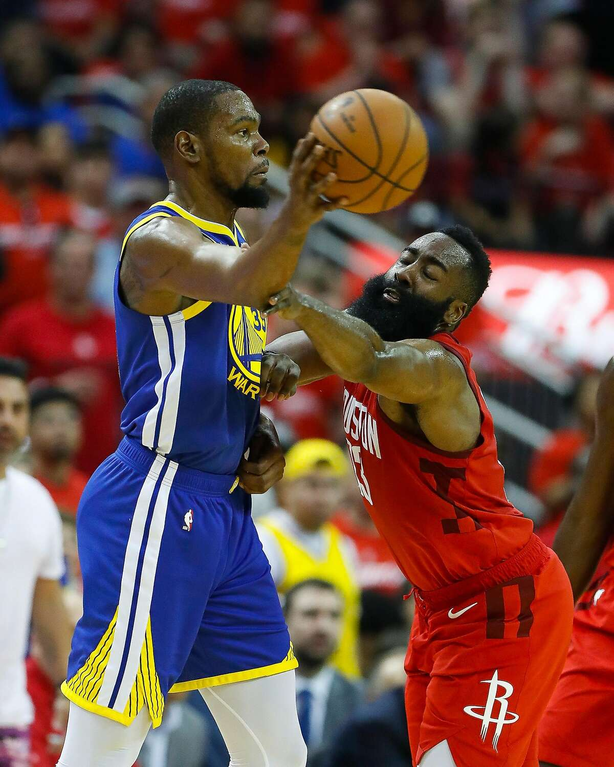 Houston Rockets guard James Harden (13) defends Golden State Warriors forward Kevin Durant (35) during the second quarter of Game 3 of a NBA Western Conference semifinal playoff game at Toyota Center, in Houston , Saturday, May 4, 2019.