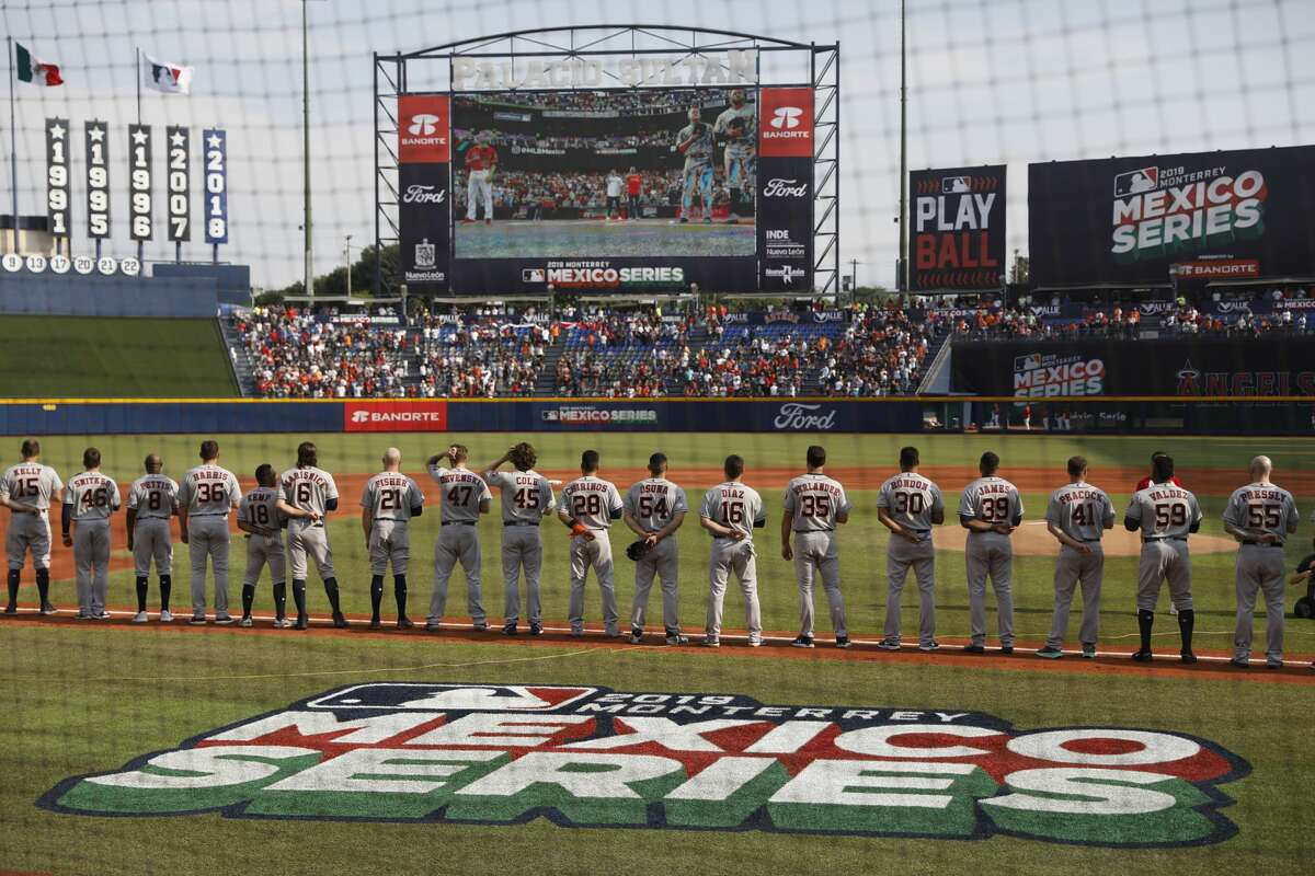 The Houston Astros stand during the playing of national anthems at the start of a baseball game against the Los Angeles Angels, in Monterrey, Mexico, Saturday, May 4, 2019. (AP Photo/Rebecca Blackwell)
