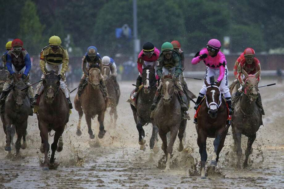 Jockey Luis Saez riding atop Maximum Security, second right, and Jockey Flavien Prat riding Country House, front left, cross the finish line during the 145th running of The Kentucky Derby at Churchill Downs in Louisville, Kentucky, U.S., on Saturday, May 4, 2019. Country House won the 145th edition of the KentuckyDerbyon Saturday after the horse that crossed the line first was disqualified. But the real winner -- and it's the same every year -- was the Duchossois family, the biggest individual shareholder ofChurchill Downs Inc. Photographer: Luke Sharrett/Bloomberg Photo: Luke Sharrett, Bloomberg News Service / © 2019 Bloomberg Finance LP
