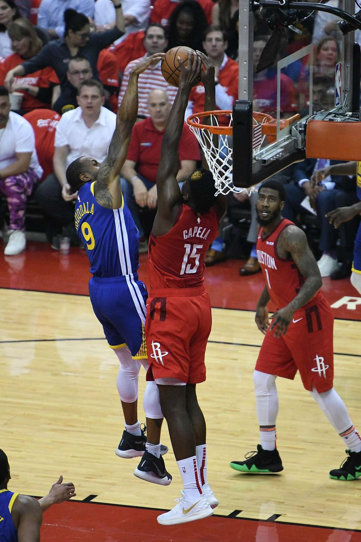 Houston Rockets center Clint Capela (15) blocks Golden State Warriors guard Andre Iguodala (9) at the rim in the first half during game 3 of the NBA Western Conference Semifinals between the Golden State Warriors and Houston Rockets at the Toyota Center in Houston, Texas, on Saturday, May 4, 2019.