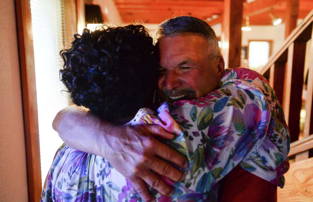 Incumbent Ward II Commissioner Mike Getz hugs a person at his watch party at the Boudain Hut Saturday evening. Photo taken on Saturday, 05/04/19. Ryan Welch/The Enterprise