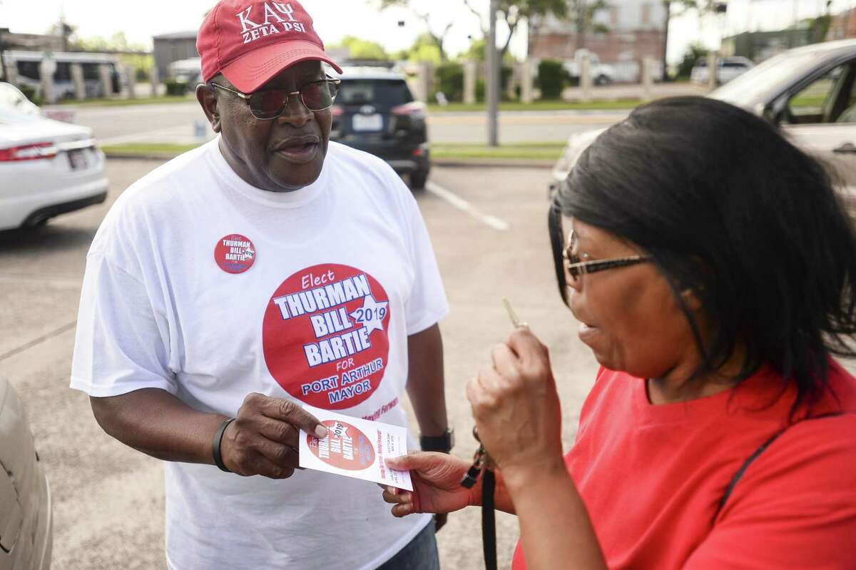 Port Arthur Mayoral candidate Thurman Bill Bartie talks to a voter outside Port Arthur city hall Saturday afternoon. Photo taken on Saturday, 05/04/19. Ryan Welch/The Enterprise