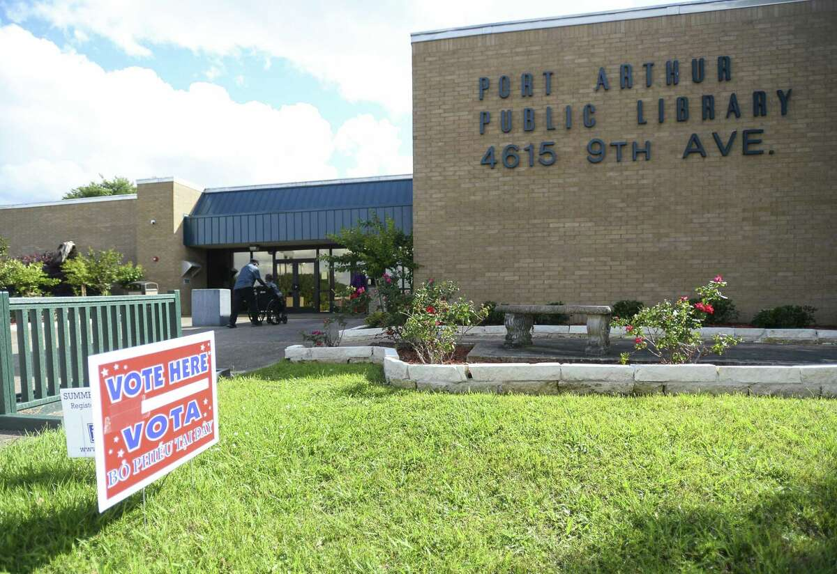 A sigh that says vote here in English and in Spanish is posed outside Port Arthur's public library Saturday afternoon. Photo taken on Saturday, 05/04/19. Ryan Welch/The Enterprise