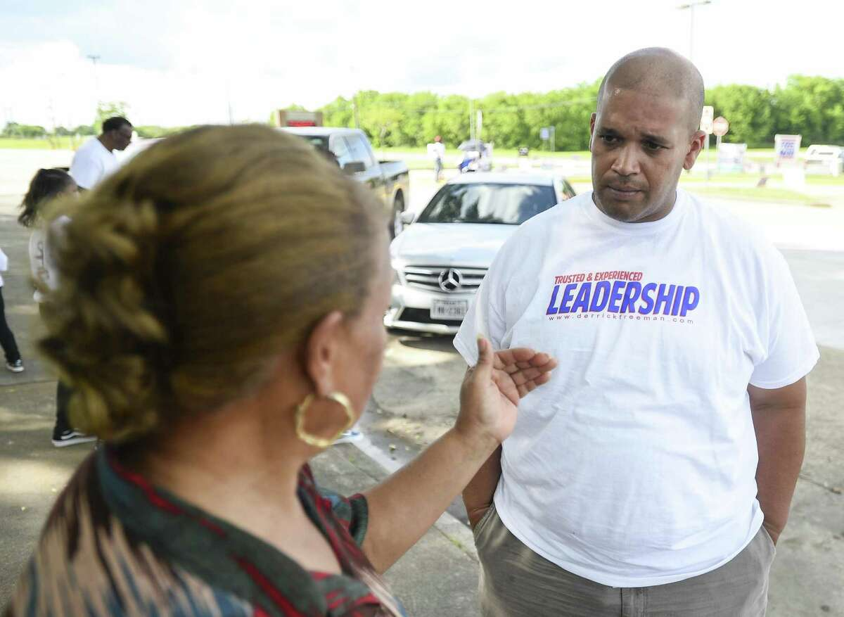 Port Arthur Mayor Derrick Freeman, who is running for re-election, talks to a voter outside Port Arthur public library Saturday afternoon. Photo taken on Saturday, 05/04/19. Ryan Welch/The Enterprise