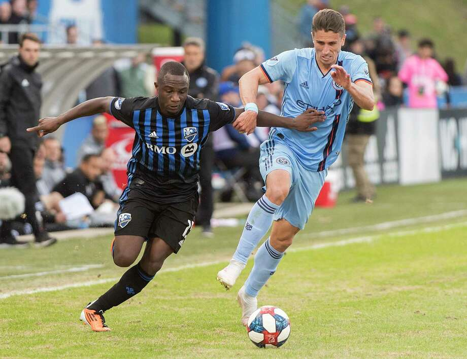 Montreal Impact's Zachary Brault-Guillard, left, battles for the ball with New York FC's Ben Sweat during the second half of an MLS soccer game in Montreal, Saturday, May 4, 2019. (Graham Hughes/The Canadian Press via AP) Photo: Graham Hughes / The Canadian Press