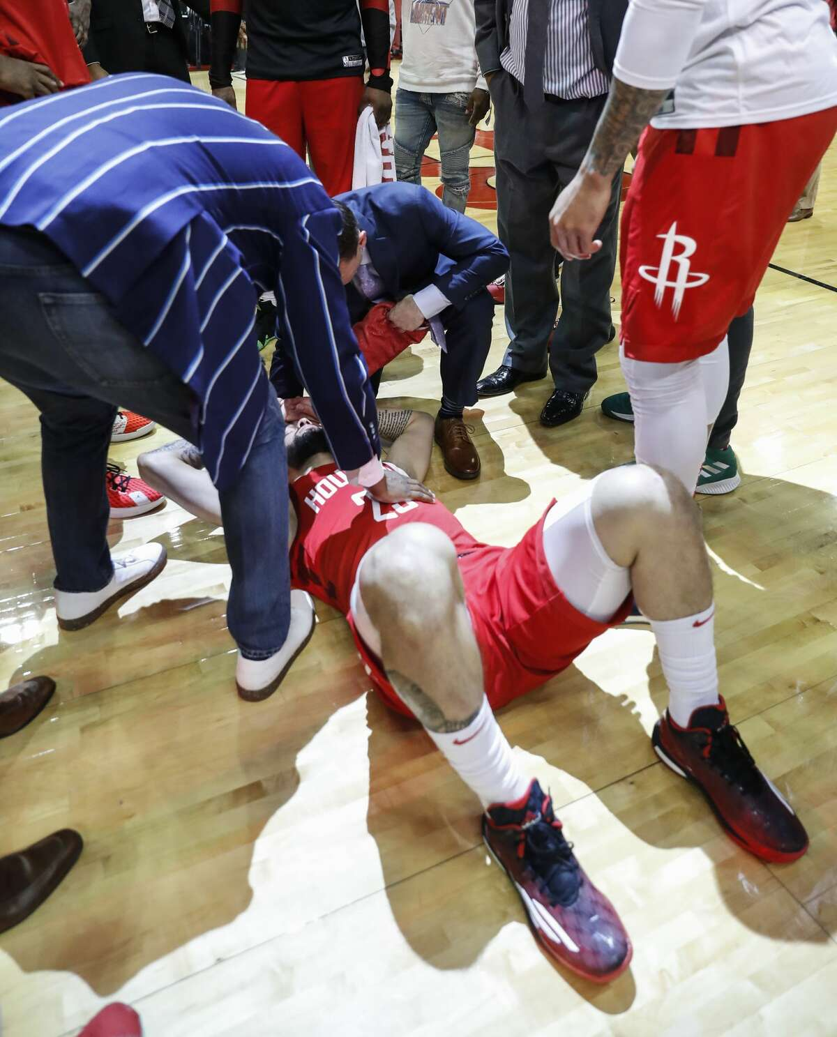 Houston Rockets guard Austin Rivers (25) lies on the ground after the Rockets win in overtime of Game 3 of a NBA Western Conference semifinal playoff game at Toyota Center, in Houston , Saturday, May 4, 2019.