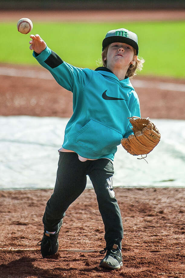 Ronan Bills, 7, throws a pitch during the annual Pitch, Hit and Run event on Saturday, May 4, 2019 at Dow Diamond. (Katy Kildee/kkildee@mdn.net) Photo: (Katy Kildee/kkildee@mdn.net)