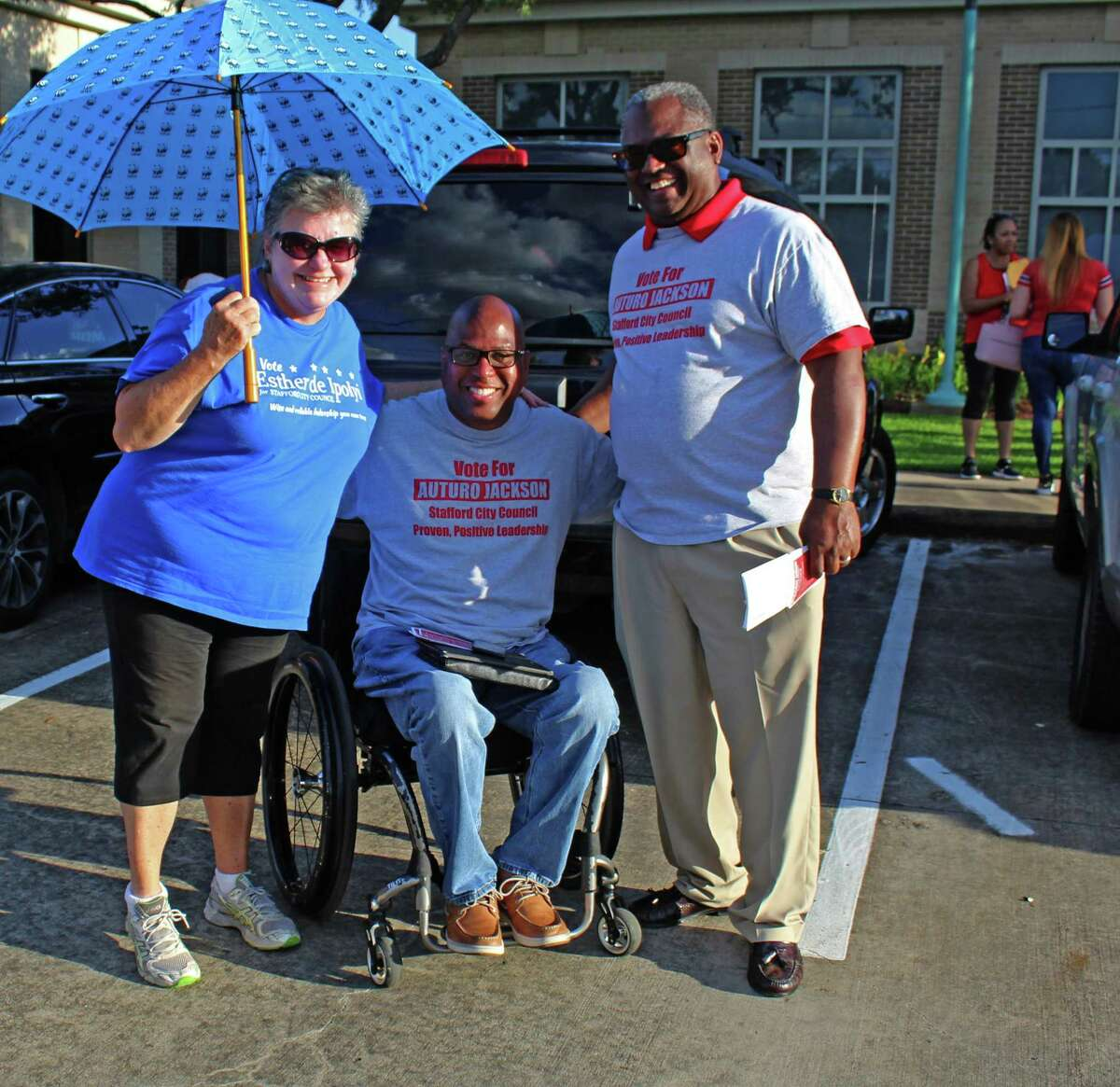 Candidates and suporters visit outside Stafford City Hall on Election Day, May 4. Pictured from left: City Council candidates Esther de Ipolyi and Arturo Jackson, supporter Michael Jackson