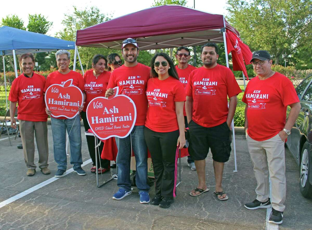 """Ashish """"Ash"""" Hamirani, candidate for Stafford MSD trustee (pictured in the center) stands with family members and supporters on Election Day, May 4, outside Stafford City Hall."""