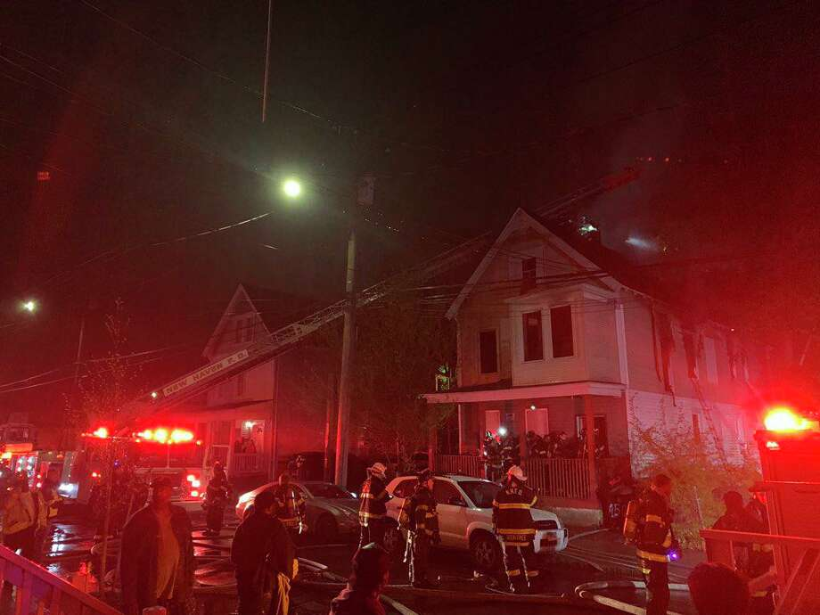 Two people were killed, while a resident and three firefighters were injured early in the morning on Sunday, May 5, 2019 in a fire that damaged a West Street home. Photo: Contributed Photo / Contributed / The News-Times Contributed