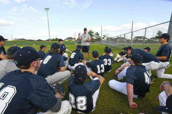 Tomball Memorial coach Monte Huggins huddles the team to talk over baseball strategy. The Wildcats were placed in District 14-6A in 2018-19, after being in Class 5A, where they finished in a tie for second place with Cy Woods.