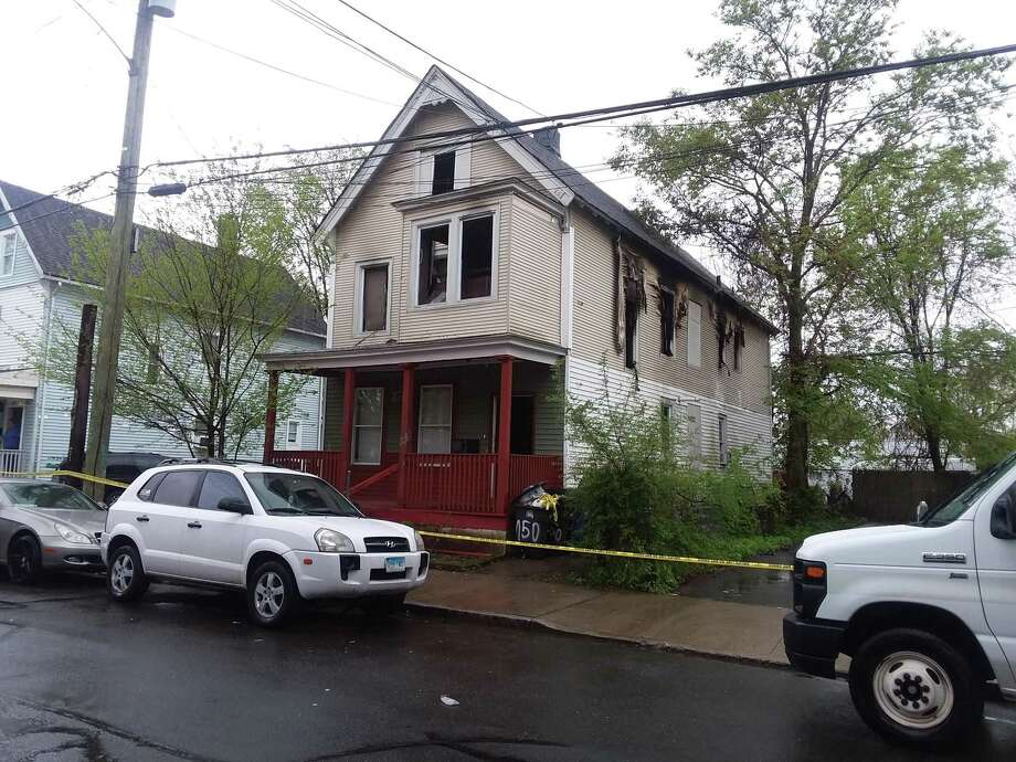 Two people were killed, while a resident and three firefighters were injured early in the morning on Sunday, May 5, 2019 in a fire that damaged a West Street home. Photo: Helen Bennett / Hearst Connecticut Media / The News-Times