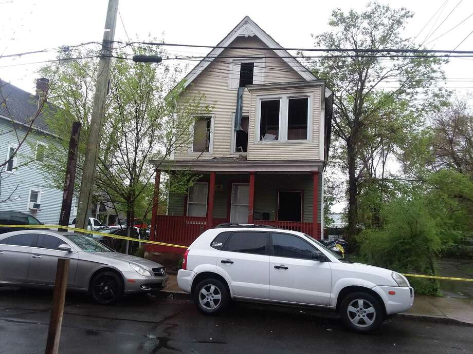 Two people were killed in a fire May 5, 2019, at a West Street home in New Haven. Photo: Helen Bennett / Hearst Connecticut Media / The News-Times