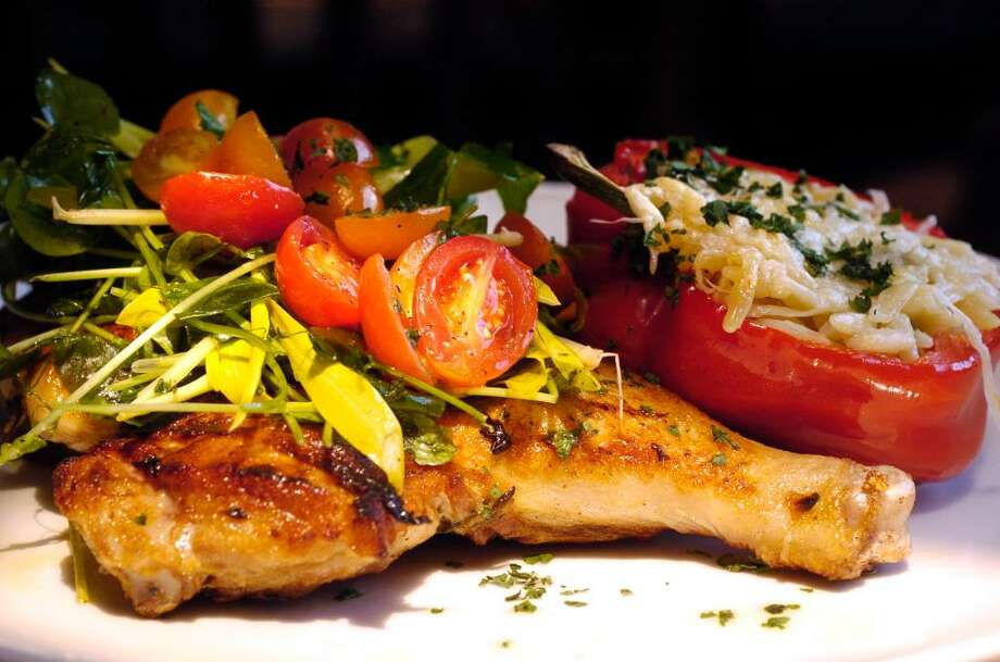 "Piergiorgio Nanni is the executive chef at The Goose restaurant in Darien, Conn. photo of main dish oven roasted free range chicken ""Al Mattone"" orzotto filled peppers, pea tendrils on Thursday July 15, 2010. Photo: Dru Nadler / Stamford Advocate"