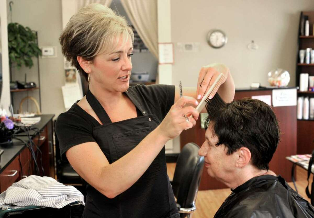 Nathalie Lariviere gives a haircut to Ginny Jess, of Newtown, at Sheer Image hair salon in Newtown, on Tuesday, July 27, 2010.
