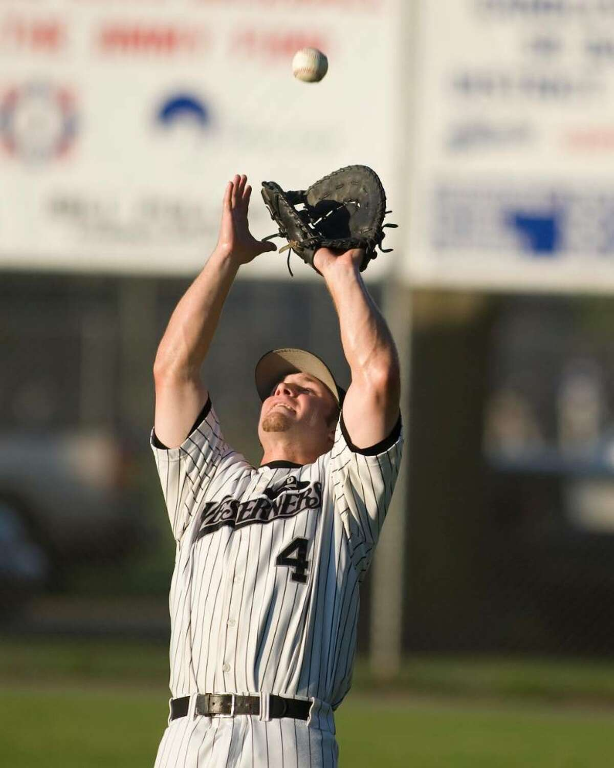 Westerners' first baseman Dave Ciocchi grabs a pop in foul territory against Briston Tuesday night at Rogers Park.