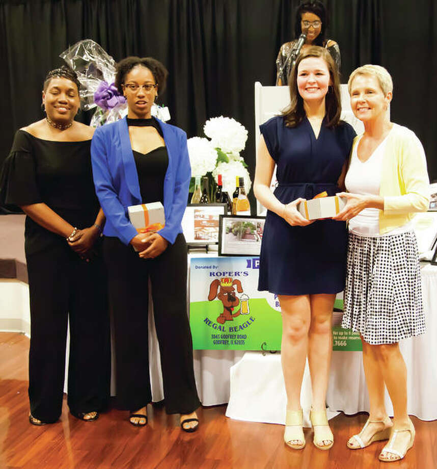 The 2019 Josephine Marley Beckwith Future Leader Scholars, Ashlynn Green and Regan Windau, were also honored during the YWCA's 29h Annual Women of Distinction Award Dinner held at the Lewis and Clark Community College Campus. Pictured (left to right) are YWCA Board Member Lisa Brown, Alton High School Senior Ashlynn Green, Edwardsville High School Senior Regan Windau, and YWCA Board Member Theresa Franklin. Raynah Ray (background) was the EMCEE for Thursday's event.
