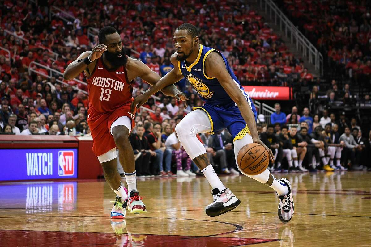 Golden State Warriors forward Kevin Durant (35) drives past Houston Rockets guard James Harden (13) during the second half in game 3 of the NBA Western Conference Semifinals between the Golden State Warriors and Houston Rockets at the Toyota Center in Houston, Texas, on Saturday, May 4, 2019.