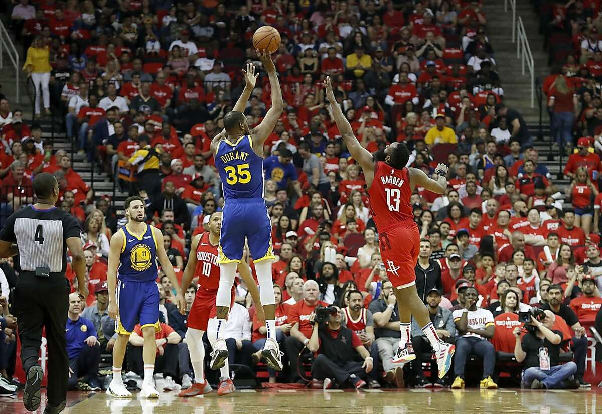 HOUSTON, TX - MAY 04: Kevin Durant #35 of the Golden State Warriors takes a three point shot defended by James Harden #13 of the Houston Rockets in the first half during Game Three of the Second Round of the 2019 NBA Western Conference Playoffs at Toyota Center on May 4, 2019 in Houston, Texas. NOTE TO USER: User expressly acknowledges and agrees that, by downloading and or using this photograph, User is consenting to the terms and conditions of the Getty Images License Agreement. (Photo by Tim Warner/Getty Images)