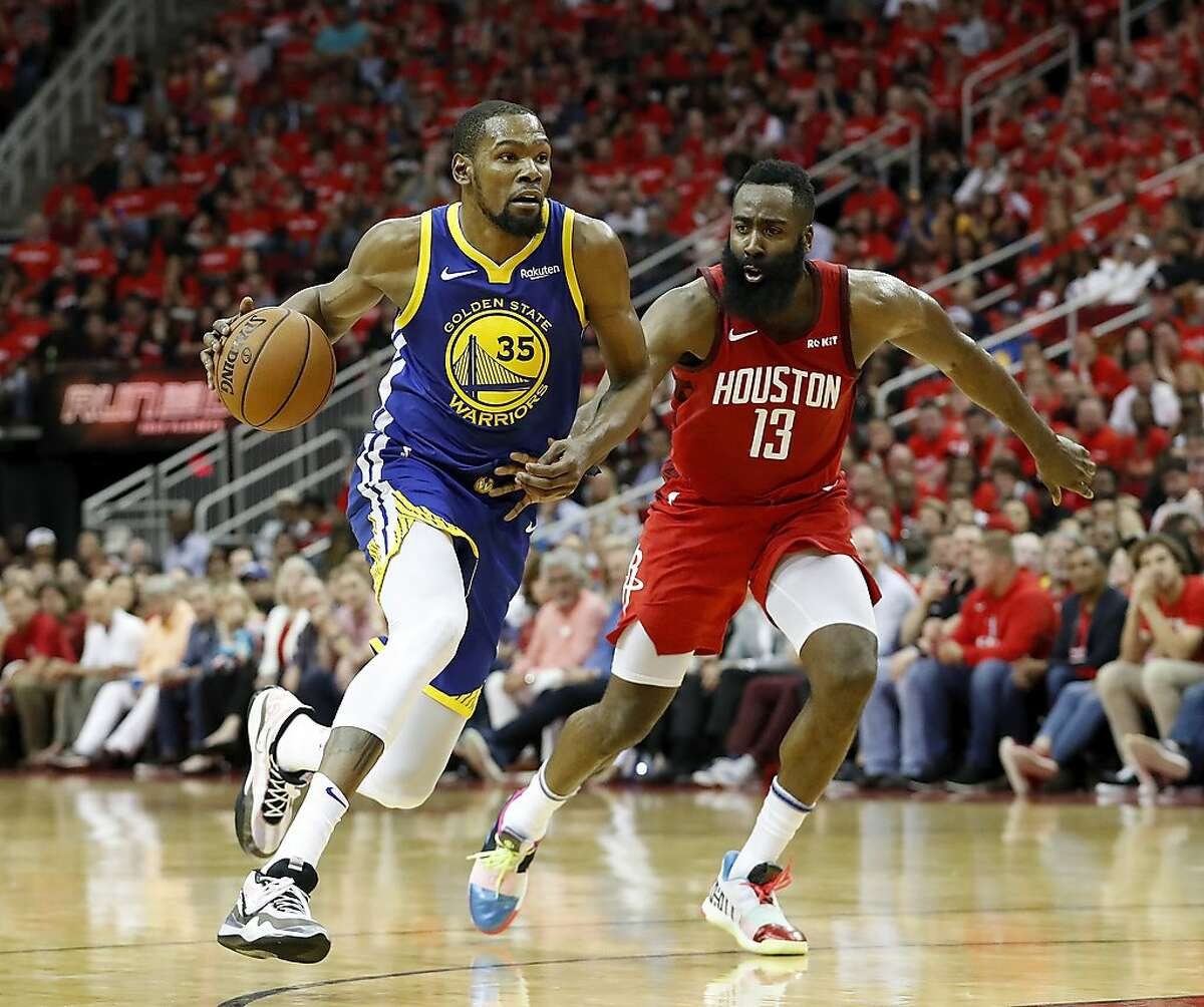 HOUSTON, TX - MAY 04: Kevin Durant #35 of the Golden State Warriors drives to the basket defended by James Harden #13 of the Houston Rockets in the fourth quarter during Game Three of the Second Round of the 2019 NBA Western Conference Playoffs at Toyota Center on May 4, 2019 in Houston, Texas. NOTE TO USER: User expressly acknowledges and agrees that, by downloading and or using this photograph, User is consenting to the terms and conditions of the Getty Images License Agreement. (Photo by Tim Warner/Getty Images)