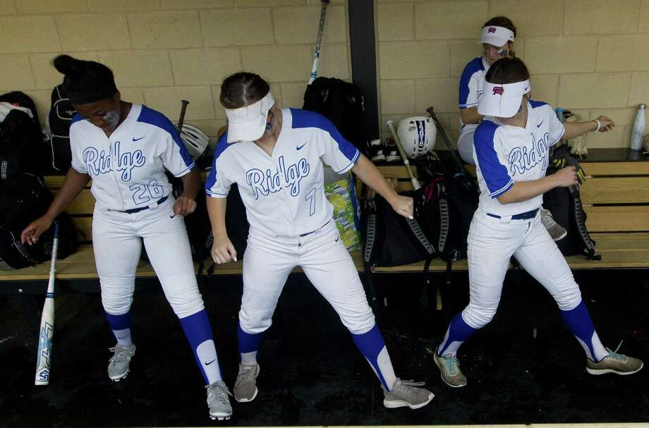 Macee Cobb #7 of Oak Ridge dances beside teammates before Game 1 of Region II-6A area high school softball playoff series at Grand Oaks High School, Friday, May 3, 2019, in Spring. Photo: Jason Fochtman, Houston Chronicle / Staff Photographer / © 2019 Houston Chronicle