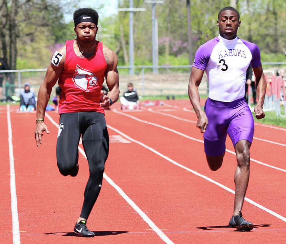 Alton's Deonte McGoy (left) beats Collinsville's Jermarrion Stewart to the finish in the 100 meters on April 20 at the Winston Brown Invitational. After Stewart lost to McGoy on both the 100 and 200 in their last two invitational matchups, Stewart picked up wins in both races over McGoy on Saturday at the Collinsville Invite. Photo: Greg Shashack / The Telegraph
